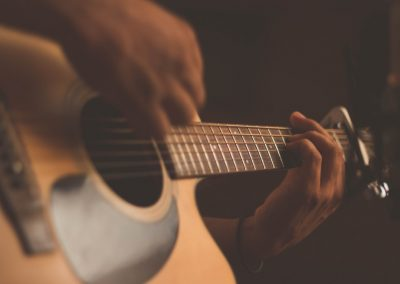 learn to play acoustic guitar Auckland